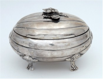 A late 18th century Russian silver casket of melon form, raised on floral decorated feet, made in St Petersburg in 1785.