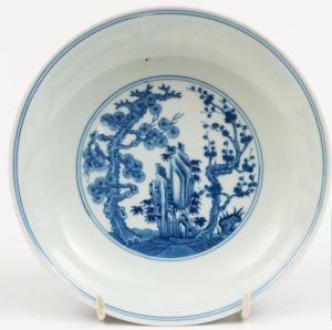 A Chinese porcelain plate painted with The Three Friends.