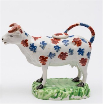 A lustrous Cambrian cow creamer from 1810.