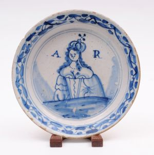 An English delft royal commemorative plate for the reign of Queen Anne.