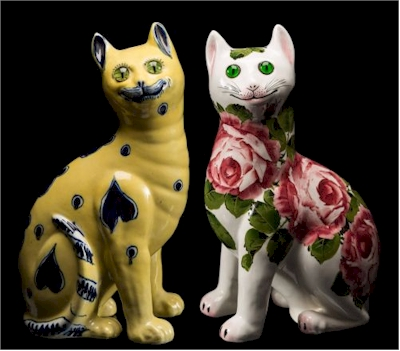 A Wemyss pottery cat with its European counterpart.