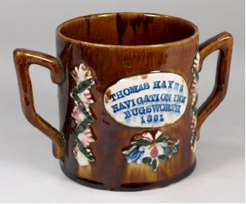 A Measham or barge ware mug for a canal side inn in the Buxton Basin