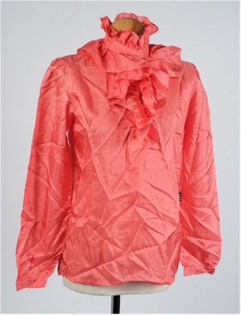 A Biba pink silk long sleeve blouse, which forms part of the collection.