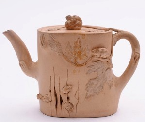 An Yixing teapot, modelled as squirrels emerging from a tree trunk, recently sold for £1,250 in our January 2013 Fine Sale (FS17/537).