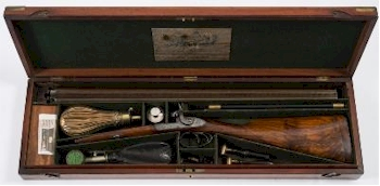 A cased double barrel percussion cap shotgun by J Purdy London est £1,800-£2,000