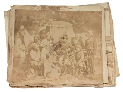 INDIA PHOTOGRAPHS a collection of 32 loose photographs, the 18 larger size (300 x 260 mm) titled on the verso in ink, possibly Frith or Bourne. The other 14 includes military figures snd groups, one is stamped 'Robinson, Dublin.' Age-toning and fading with short edge tears, c1860s.