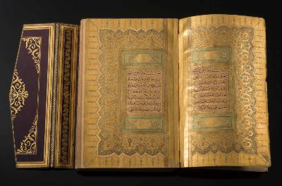 Sale BK14; Lot: 0101: KORAN Illuminated manuscript, 410 pages, 221 x 141 mm, cont red gilt morocco, with matching doublures, gilt edges, with flap, AH 1293 [1876 A D]. * the caligrapher Yayya Hilmi ''Efendi'', the illumination is of outstanding quality, including a magnificent double frontispiece, decorated in two tones of gold, light green and pale blue. Each panel of text is within a thick gold border with decorations in the margins. The tissue guards protecting the frontispiece are also exquisitely illuminated. This manuscript belongs to the Court style of Ottoman manuscripts, made as gifts and endowments. It was therefore most probably produced in Constantinople.