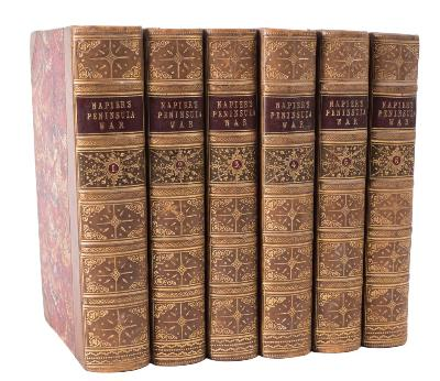 Sale BK19; Lot: 0345: NAPIER, Sir W F.P - History of the War in the Peninsula and in the South of France 6 vol. set, half tan calf, extra gilt on the spines with contrasting morocco labels, 8vo, T & W Boone, 1851.