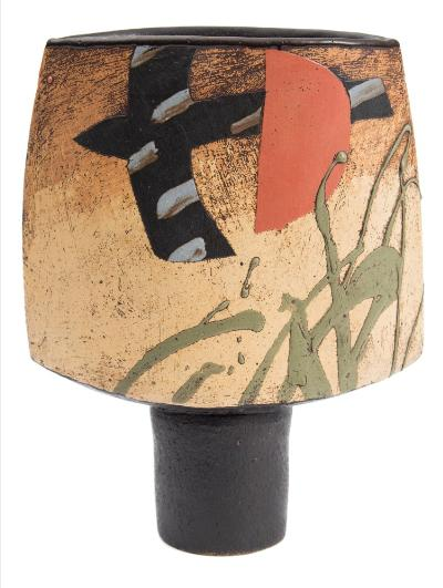 John Maltby [b 1936] a stoneware vase of spade shaped form with stencil and splashed decoration of a bird in flight on a textured graduating cream brown ground, the matt black reverse and stem with splashes of red, signed Maltby to underside, 23.5cm high.
