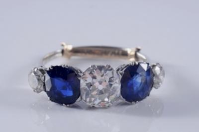 Sale FS10; Lot: 0191: A sapphire and diamond five stone half hoop ring.