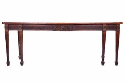 A George III mahogany serpentine-fronted serving table.