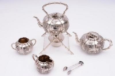 A Chinese silver four piece tea service.