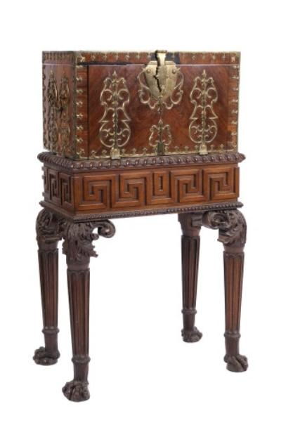 Sale FS14; Lot: 0862: A Louis XV brass mounted kingwood coffre fort on later walnut stand, the rectangular body applied with brass trefoil edge mouldings, pierced brass curvilinear strap hinges, escutcheon and carrying handles, the interior with removable trays, the fall front enclosing two drawers, the later stand with Greek key pattern frieze and fluted legs headed by acanthus scrolls and ending in lion paw feet, 54cm (1ft 9 1/4in) wide.