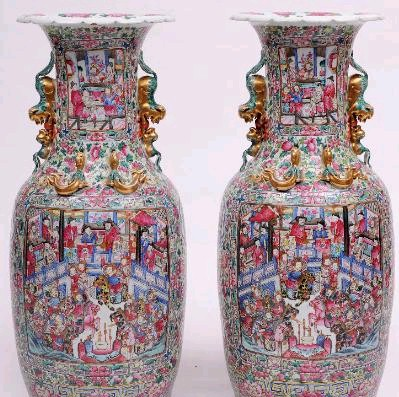 Sale FS17; Lot: 0525: A large pair of Canton porcelain vases of shouldered oviform with raised flaring neck, the neck and shoulders applied with opposing Kylins and chilongs, enamelled front and verso with panels of warriors and other figures within a courtyard, with smaller subsidiary panels containing lotus and pairs of figures reserved on a profuse ground of fruit, peony and other blooms, 98.5cm high, circa 1880-1890.