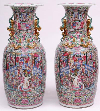 A large pair of Canton porcelain vases of shouldered oviform with raised flaring neck, the neck and shoulders applied with opposing Kylins and chilongs, enamelled front and verso with panels of warriors and other figures within a courtyard, with smaller subsidiary panels containing lotus and pairs of figures reserved on a profuse ground of fruit, peony and other blooms, 98.5cm high, circa 1880-1890.