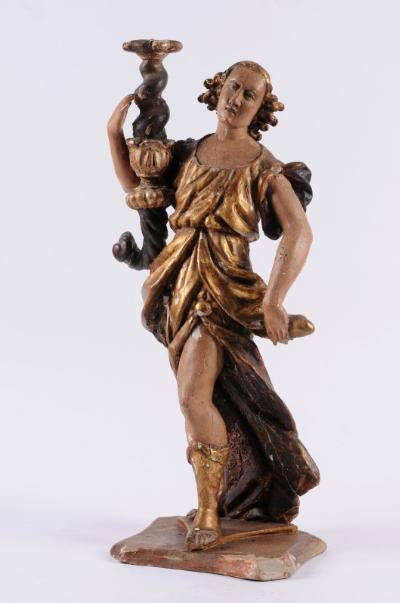 A 17th century Continental carved giltwood and polychrome decorated figure of a woman dressed in classical robes, possibly representing 'Victory' and holding a torch in her right hand, mounted on a shaped rectangular base, 65cm high, probably Spanish.