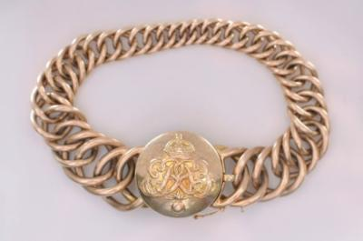Sale FS18; Lot: 0187: An early 20th century gold graduated curb-link bracelet with circular locket clasp decorated with monogram above grenade for the 'Grenadier Guards' and opening to reveal a portrait photograph.