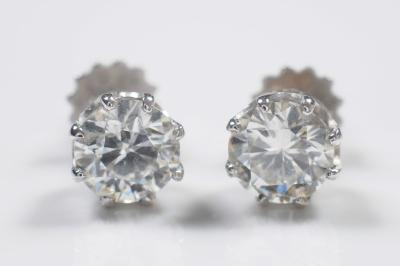 A pair of diamond single stone ear studs, each with a circular, brilliant-cut stone approximately 6.3mm and 6.25mm diameter, estimated to weigh 0.98cts and 0.95cts respectively in curtain claw setting.