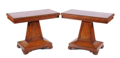 A pair of Regency pollard oak rectangular card tables in the manner of George Bullock, the rectangular baize lined hinged tops with reel turned edges and moulded panel friezes, on tapering moulded panel columns and bevelled stepped rectangular plinths, terminating in scroll and reeded block feet, 97cm (3ft 2in) wide.