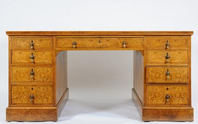 Sale FS20; Lot: 1112: An Edwardian walnut, mahogany and floral marquetry partners kneehole desk, crossbanded and bordered with boxwood lines and decorated with a marquetry of scrolling floral foliage, the rectangular top inset with a panel of tooled leather, fitted to one side with a central kneehole drawer, flanked by four short drawers to either side, to the other a false drawer and a pair of enclosed cupboards on plinth bases, the top 153cm (5ft 0 1/4in) x 94cm (3ft 1in).