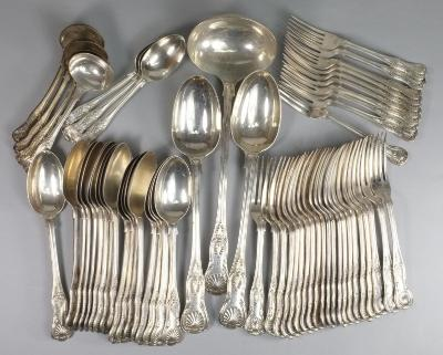 A Victorian Kings pattern part flatware table service, maker William Gibson and John Langman, London, 1899, crested, comprising twenty one table forks, ten dessert forks, seventeen table spoons, three dessert spoons, four sauce ladles, one soup ladle and one pair of serving spoons, 187.16 ozs.