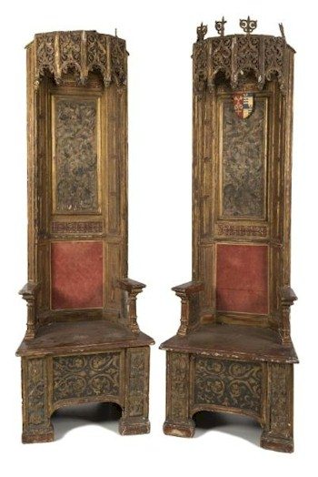 Sale FS22; Lot: 0974: By Direction of the Dean and Chapter of Exeter Cathedral - A pair of 16th Century Italian carved giltwood and polychrome decorated thrones, the high panelled backs with arcaded pendant hung canopies of half dodecogonal form, pierced and decorated with scrolling foliage, one with foliate scroll finials, the other lacking and with vaulted interiors of star shape, each with a central pendant, the polychrome decorated rectangular panels with female figures and birds amidst scrolling foliage, between canted panelled stiles in gilt with red and gilt decorated reserves, the box seats with short arm supports on turned uprights, having panels with coat of arms to either side, the seats with central Moresque decorated panels, flanked by stiles with raised masks and foliage, on block feet, Circa 1620, 223.5cm (7ft 4in) high, the seats 74cm (2ft 5in) wide. *Note A gift to Exeter Cathedral by the Reverend Sir Patrick Ferguson Davie BT, Circa 1960 of Creedy Park, Devon. Purchased in London the thrones are discussed in Charles Tracy's book Continental Church Furniture in England - A Traffic in Piety, pages 138 - 139.