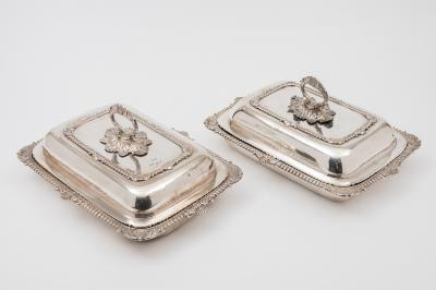 A pair of George III rectangular entree dishes and covers, maker W E, London 1814 of rectangular outline with gadrooned and foliate decorated borders and foliate capped detachable handles, 34cm wide, 12887ozs.