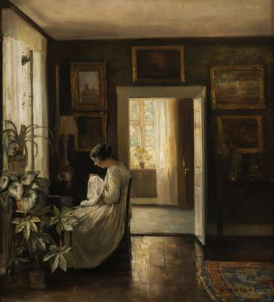 Carl Wilhelm Holsoe [Danish 1863-1935] - An interior scene with a lady seated wearing a white dress, sewing by a window, a view to a sunlit room beyond - signed C Holsoe bottom right oil on canvas 58 x 53cm.