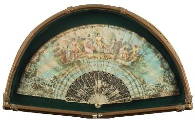 A 19th Century French fan the lithographed paper leaf decorated with a scene of fairies in a woodland glade, with pierced ivory and gilt decorated sticks and guards, 25cm long, contained in a gilt case.