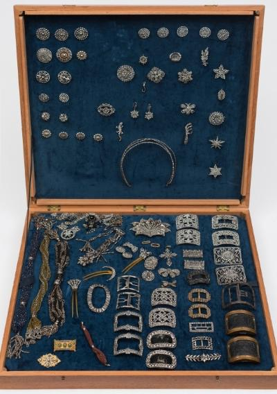 An extensive collection of 18th, 19th and early 20th century steel cut jewellery, buckles, purses and other collectables includes seven pairs of buckles, chataleine, hair combs, spray and bow brooches, lizard and butterfly brooches, earrings, crucifix, cocktail and clutch purses, necklace and bracelet, together with numerous buttons of different designs, contained in a mahogany case.