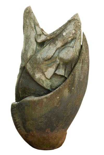 A reconstituted stone garden ornament in the form of a fish's head with open mouth, 130cm high.