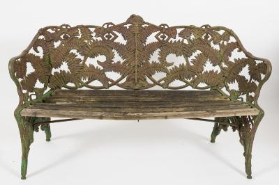 A Victorian 'Coalbrookdale type' fern pattern cast iron garden seat, with wood slatted seat, 154cm (5ft 0 1/2in) long.