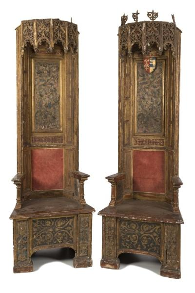 By Direction of the Dean and Chapter of Exeter Cathedral - A pair of 16th Century Italian carved giltwood and polychrome decorated thrones, the high panelled backs with arcaded pendant hung canopies of half dodecogonal form, pierced and decorated with scrolling foliage, one with foliate scroll finials, the other lacking and with vaulted interiors of star shape, each with a central pendant, the polychrome decorated rectangular panels with female figures and birds amidst scrolling foliage, between canted panelled stiles in gilt with red and gilt decorated reserves, the box seats with short arm supports on turned uprights, having panels with coat of arms to either side, the seats with central Moresque decorated panels, flanked by stiles with raised masks and foliage, on block feet, Circa 1620, 223.5cm (7ft 4in) high, the seats 74cm (2ft 5in) wide. *Note A gift to Exeter Cathedral by the Reverend Sir Patrick Ferguson Davie BT, Circa 1960 of Creedy Park, Devon. Purchased in London the thrones are discussed in Charles Tracy's book Continental Church Furniture in England - A Traffic in Piety, pages 138 - 139.