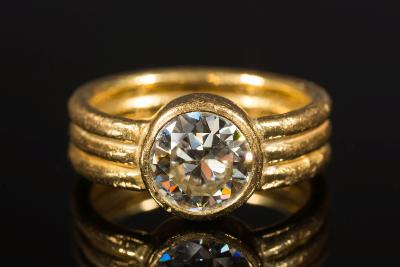 A diamond single stone ring, stated to be the work of Charmian Harris with a single round old brilliant-cut diamond estimated to weigh 2.1cts, 10gms gross weight.