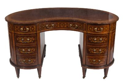 Sale FS24; Lot: 0832: An Edwardian mahogany and marquetry kidney-shaped kneehole writing desk or dressing table, crossbanded in satinwood, bordered with boxwood and ebonised lines, the top with a wide banded and moulded border decorated with flowerheads and husks, containing a central apron drawer flanked by four short drawers to either side, decorated with anthemions, foliate motifs and scrollwork, between satinwood simulated fluted pilasters, the front with panels of ribbon tied drapery, oval fan and husk medallions and neo-classical urns and scrolling foliage, on square tapered legs, terminating in castors, 139cm (4ft 6 3/4in) wide.