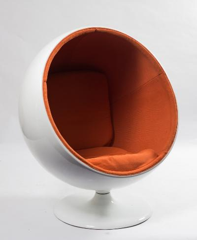 A white fibreglass 1960s ball chair after the design by Eero Aarnio, with interior orange folkweave upholstery and with cushion back and loose cushion seat, on a circular swivel base, 125cm (4ft 1in) high.