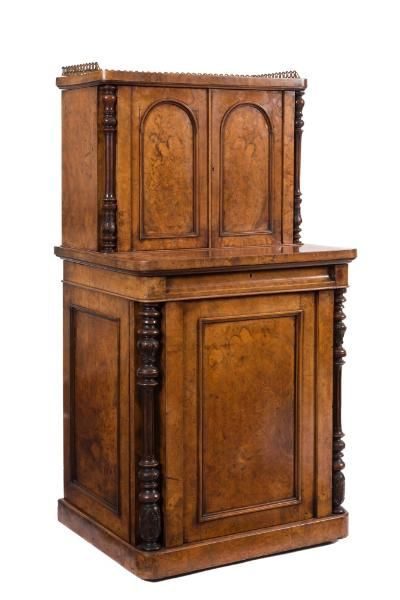A Victorian burr walnut veneer writing cabinet, the upper part with a pierced brass three quarter gallery, having a maple veneered interior with pigeon holes and four small central drawers, enclosed by a pair of domed moulded panel doors, flanked by turned, fluted and foliate carved column uprights, the lower part having a cushion frieze fitted writing drawer with tooled leather inset hinged writing surface, having a moulded panel front, with turned, fluted and foliate columns and cupboards to either side, one being fitted with three slides, the other with four small drawers, each enclosed by a moulded panel door, on a plinth base, 63.5cm (2ft 1in) wide, 121cm (3ft 11 3/4in) high.