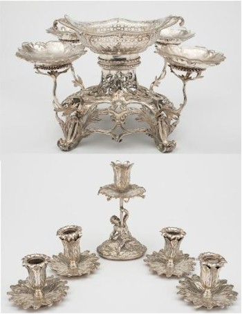 Sale FS26; Lot: 0144: An early George III silver table centrepiece, maker Thomas Hemming, London, 1765 bears Lovell family coat of arms, surmounted with a lozenge-shaped dish with pierced foliate and trellis decoration with glass liner, the domed shaped base, with beaded order to the neck, pierced foliate, scroll and flowerhead chased decoration, on four swept feet, having four swept branches each with a foliate circular dish with glass liners, 28cm wide, 26cm high, together with a set of four plated candle holders and central candle holder supported by a putto to convert the centrepiece to a candelabra, total weight of silver 79.42ozs.