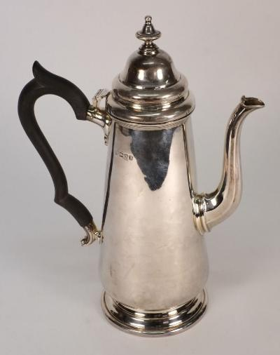 A George V silver coffee pot, maker HEB FEB, Chester, 1911in the Georgian taste, with domed hinged lid with urn finial, of tapering ovoid form on a spreading circular foot, 25cm high, 14.01ozs.