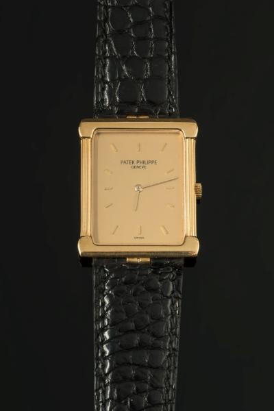 Patek Philippe. A gentleman's 18ct gold Patek Philippe dress wristwatch model number 3775, the rectangular gold colour dial with baton markers, the movement numbered 1366634in an 18ct gold case numbered 2813135 on leather strap.