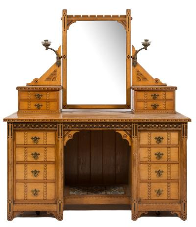 A late Victorian ash and inlaid bedroom suite in the Aesthetic taste, with walnut banded geometric lozenge friezes, bordered with boxwood and ebonised lines, comprising a three section wardrobe, with castellated pediment enclosed by a central arched mirror door, flanked by an enclosing hanging cupboard to either side and with three drawers at the base, 212cm (6ft 1 1/2in) wide, 216cm (7ft 1in) high, a dressing chest with swing frame mirror superstructure and four small drawers, having four short drawers to either side of an open recess with floral geometric tiled base, 138cm (4ft 6 1/4in) wide, a rectangular washstand with white marble superstructure and tiled back, on turned column and trestle end supports, 129cm (4ft 3in) wide, a pedestal cupboard, 40.5cm (1ft 4in) and a pair of cane seat occasional chairs.