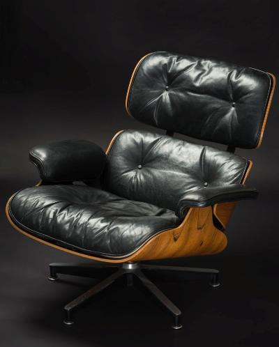Charles (1907-1978) & Ray (1912-1988) Eames, lounge chair for Herman Miller, black leather upholstery, moulded back and seat on an aluminium stand.
