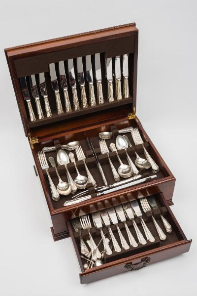 An Elizabeth II silver Dubarry pattern flatware service, maker United Cutlers Ltd, Sheffield, 1993 includes, twelve table knives, twelve dessert knives, twelve table forks, twelve dessert forks, four table spoons, twelve dessert spoons, twelve soup spoons, twelve teaspoons, twelve fish knives, twelve fish forks, cheese knife, cake knife, carving knife, steel carving fork, contained in a mahogany canteen, weighable silver 181.99ozs.
