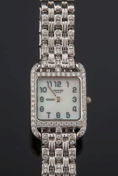 Hermes. A lady's 18ct white gold and diamond mounted 'Cape Cod' wristwatch, the square mother of pearl dial with Arabic numerals surrounded by brilliant-cut diamonds in a case numbered 'CC1-192' and '1116434'.
