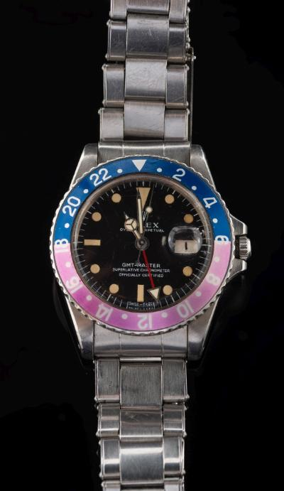 Rolex. A gentleman's stainless steel 'Rolex Oyster Perpetual GMT Master Superlative Chronometer Officially Certified' wristwatch, the circular black dial with luminescent 'Mercedes' hands and markers, magnified date aperture and revolving 'Pepsi' bezel on steel bracelet.