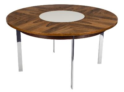 Design by Richard Young circa 1960-1970 - A Merrow Associates rosewood and chromium circular dining table and six chromium frame and cream leather dining chairs, the circular rosewood dining table with inset cream laminate 'Lazy Susan', on four chromium oblong legs, 136.5cm (4ft 5 3/4in) diameter, the dining chairs with continuous curved cream leather backs and seats on chromium bases.