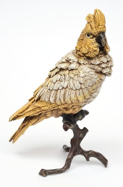 A Bergman cold painted bronze model of a yellow and white Cockatoo perched on a naturalistic stump, stamped Geschutzt, with Bergman vase stamp, 33053, 31cm high.