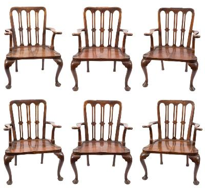 Sale FS28; Lot: 0782: A rare set of six early 18th Century walnut open armchairs, the cartouche shaped backs with arcaded top rails with paper scroll crestings, having triple pierced vertical splats, shaped scroll arm supports and escutcheon shaped solid legs, terminating in pad feet.