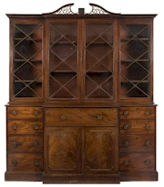 Sale FS29; Lot: 1091: A George III mahogany breakfront secretaire library bookcase, with pierced fret, the upper part with a pierced fret central swan neck pediment, enclosed by a pair of central astragal glazed panel doors, flanked by an enclosed astragal glazed cupboard to either side, the lower part having a central fall enclosing a fitted interior with small drawers and pigeon holes, the cupboard below enclosed by a pair of doors flanked by four short drawers to either side, on a plinth base, 201cm (6ft 7in) high, 235cm (7ft 8 1/2in) high.
