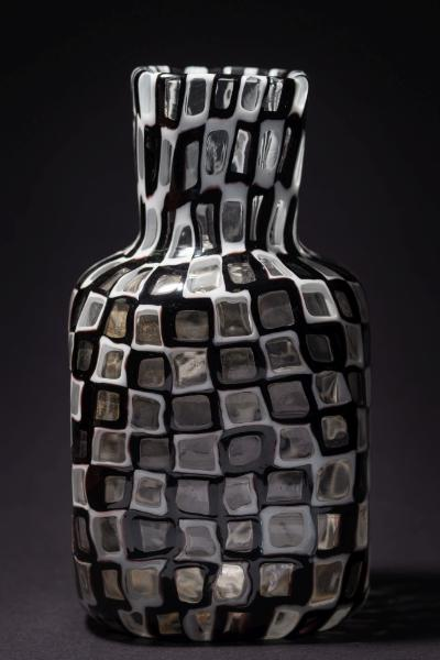 A Venini 'Occhi' vase by Tobia Scarpa of square bottle shape formed from dark amethyst, white and clear square 'murrine', acid etched Venini, Murano, Italia, circa 1950-60, 20cm high.
